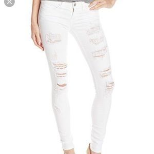 Flying monkey distracted white skinny jeans